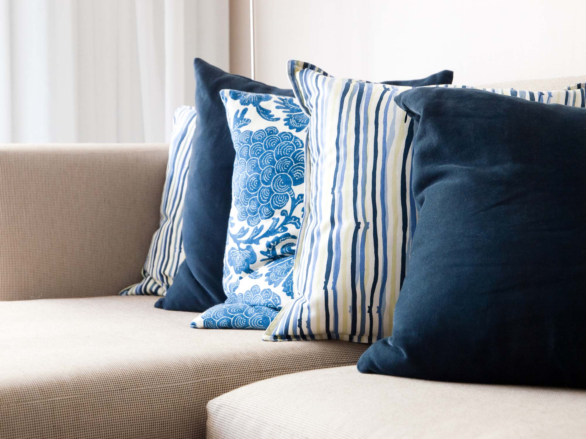 Blue pattern cushions on sofa